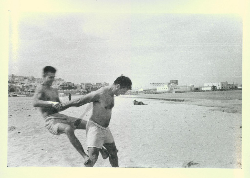 Jack Kerouac and Peter Orlovsky horsing around on the beach, Tangier