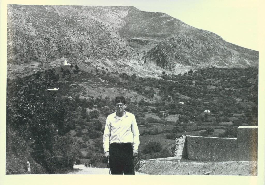 Allen Ginsberg in front of hillside, Xauan, Morocco