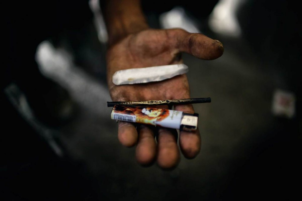 A homeless man in Western Kabul reveals his instruments for smoking opium resin and heroin (Source: Wikimedia Commons)