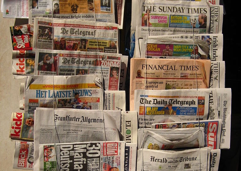 newspapers (Source: Wikimedia Commons)