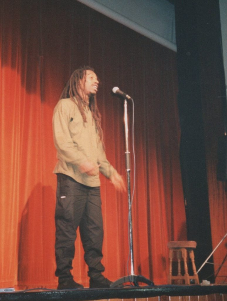 Dr Benjamin Zephaniah performs for the Alchemy Defence Fund event at LSE.